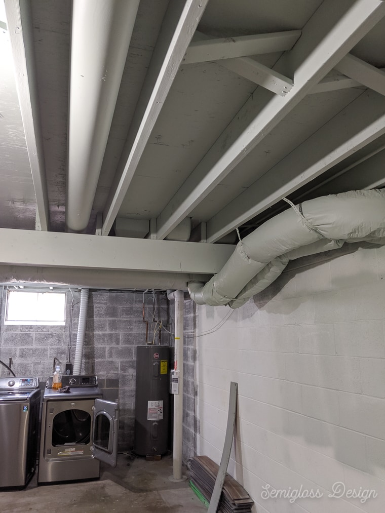 painted pipes and ducts in basement ceiling