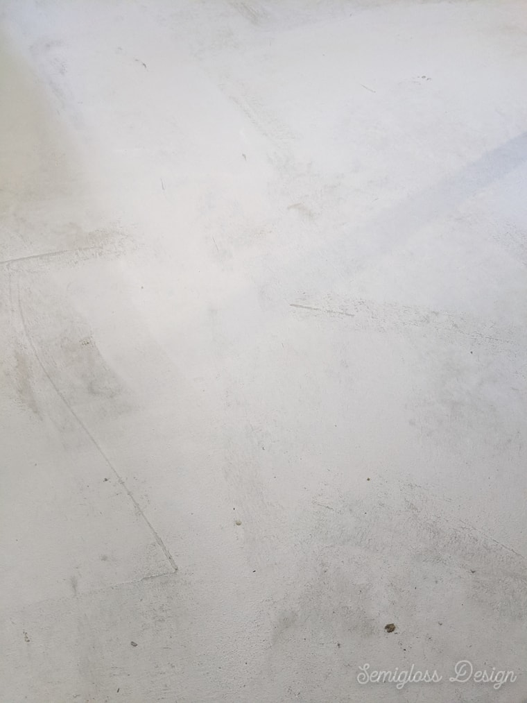 refinishing a concrete floor with a skim coat