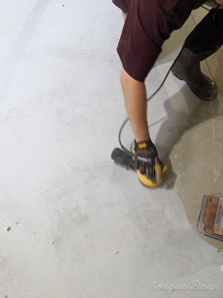 sanding the concrete overlay between coats