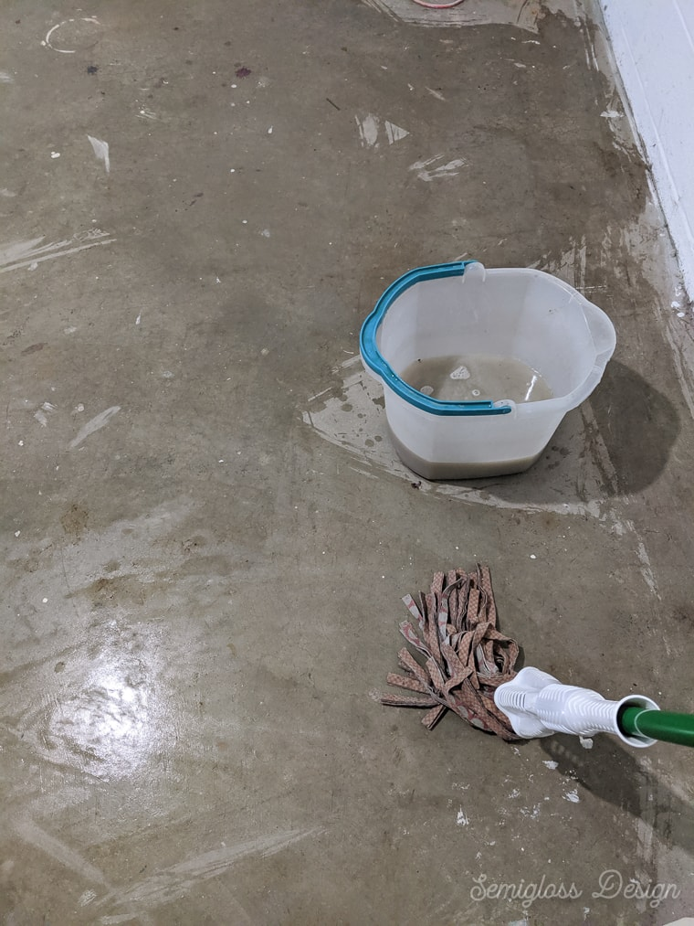 mopping cement floor to clean paint overspray