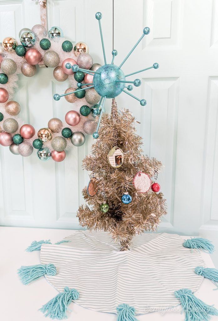 atomic tree topper on mini tinsel tree