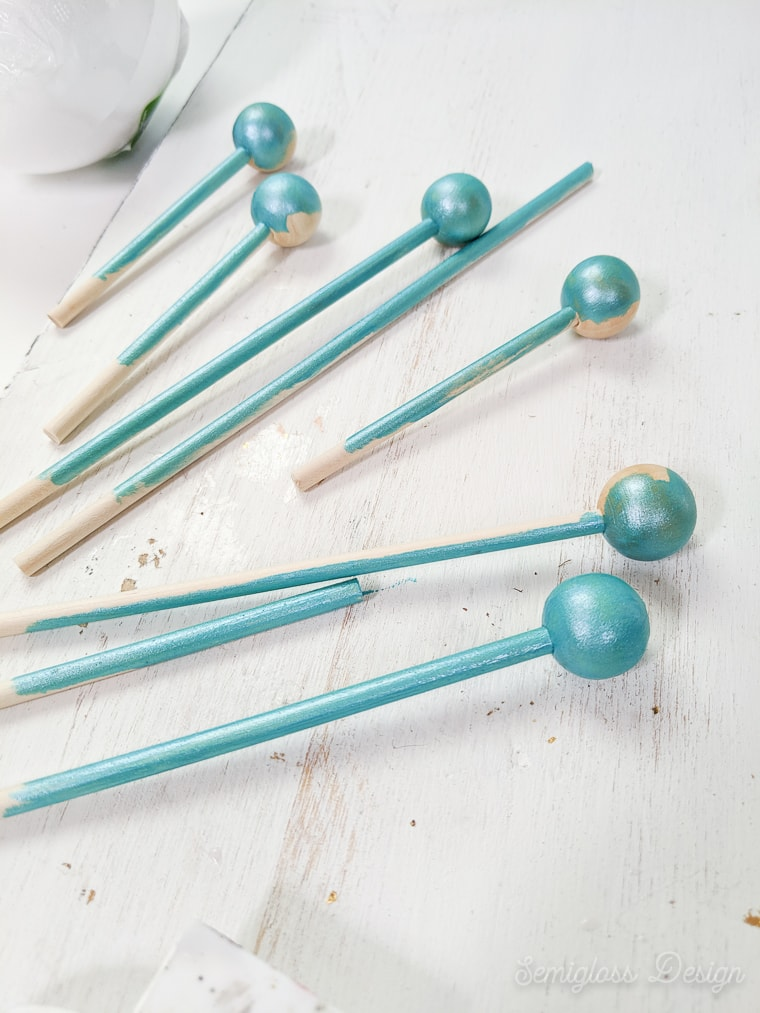 painting dowels with beads for tree topper