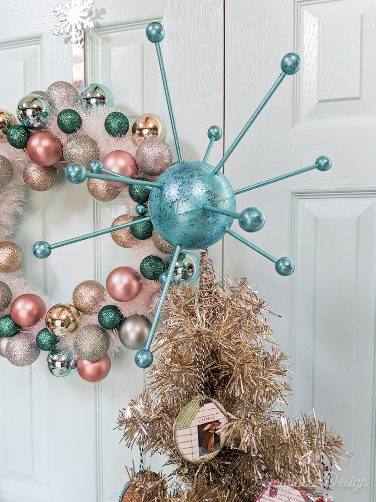 atomic tree topper on vintage tinsel christmas tree