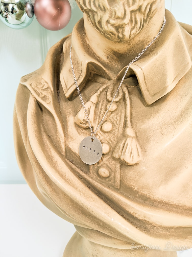 "close up of ""salty necklace on plaster bust of Shakespeare"