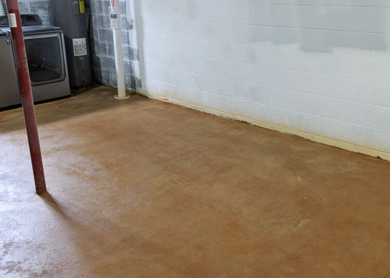stained concrete floor in Kemiko Malay Tan in basement