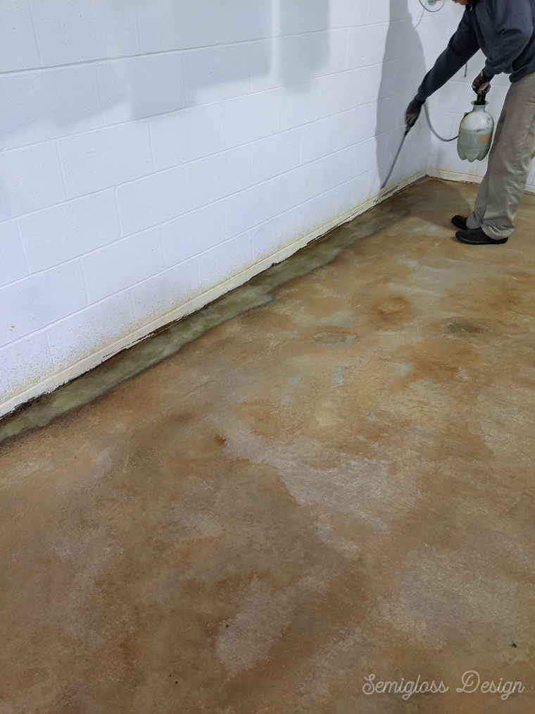 spraying 2nd coat of concrete stain