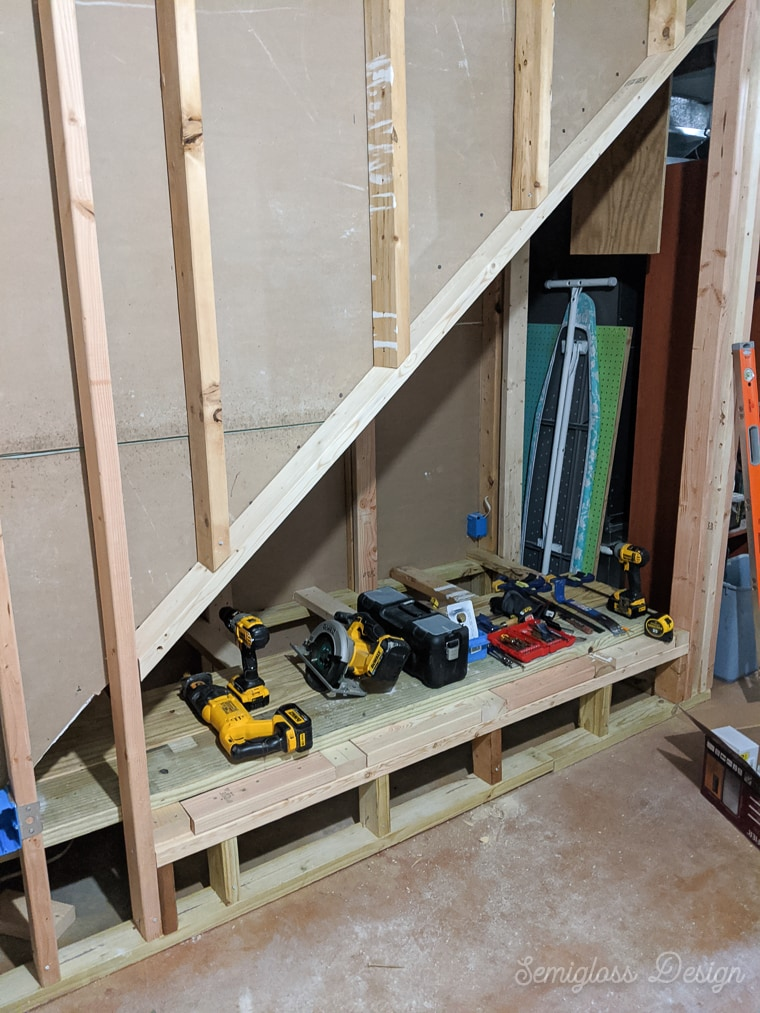 partially framed area under stairs in basement