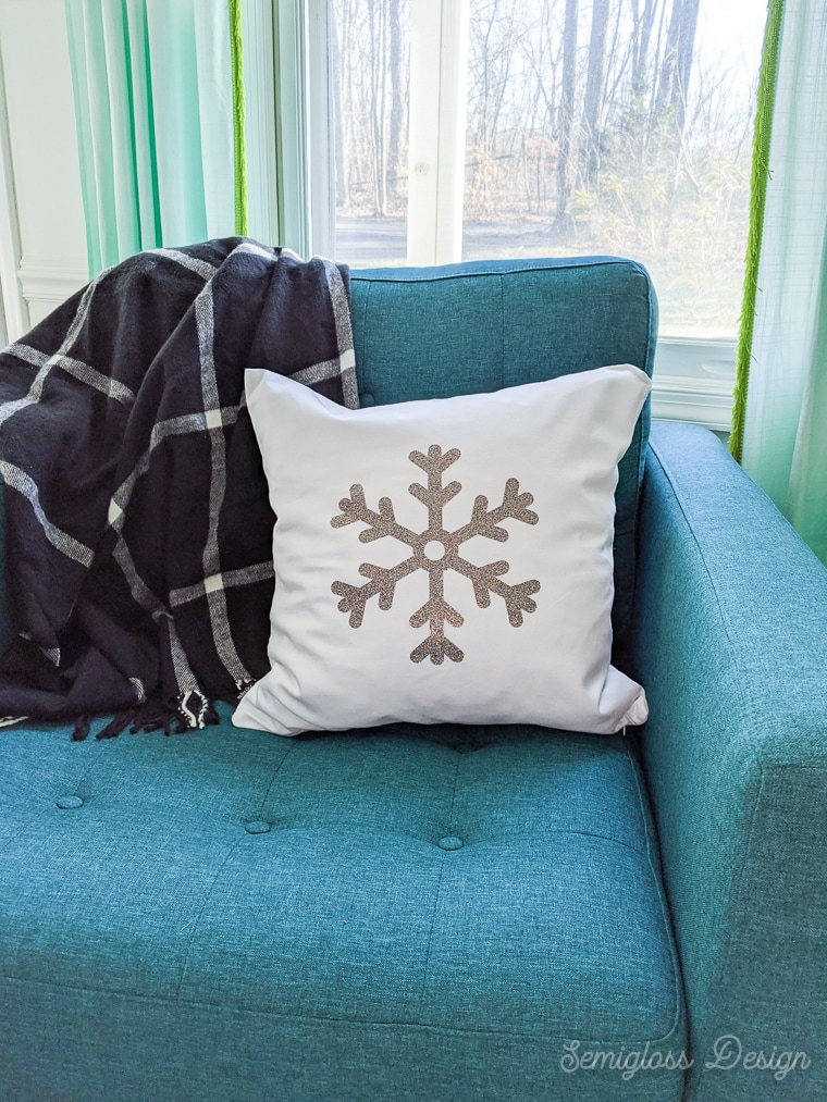 glitter snowflake pillow on turquoise chair