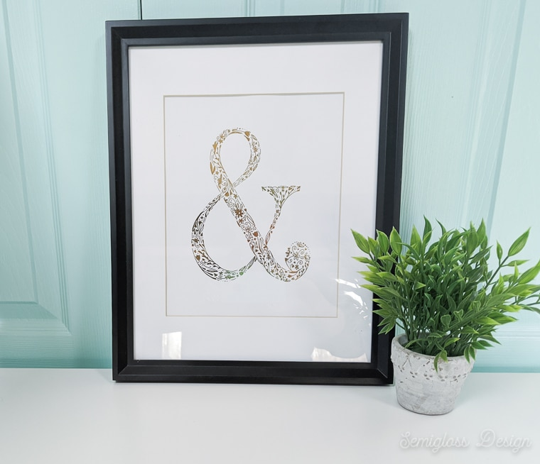 gold foil ampersand art in frame
