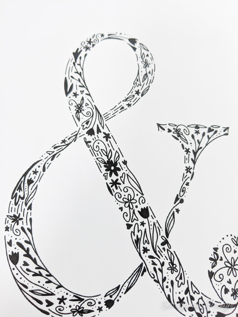 close up of floral ampersand art