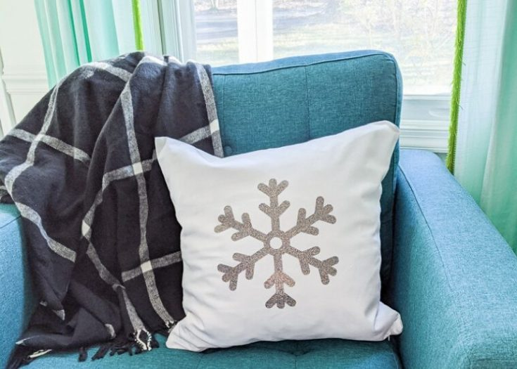 snowflake pillow on teal chair
