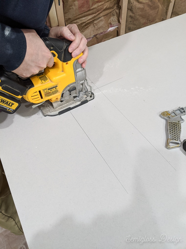using jigsaw to cut hole for electrical box in drywall