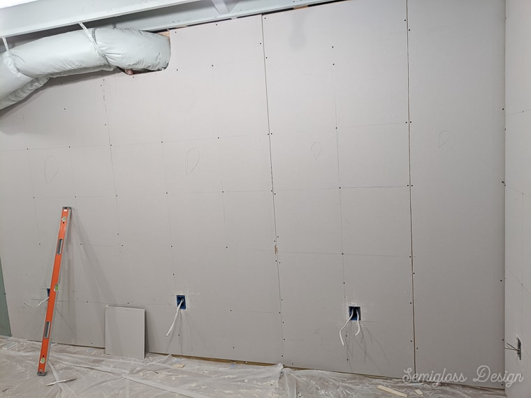 installing drywall in a basement