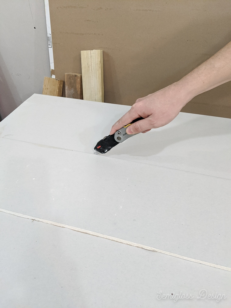 using utility knife to score drywall