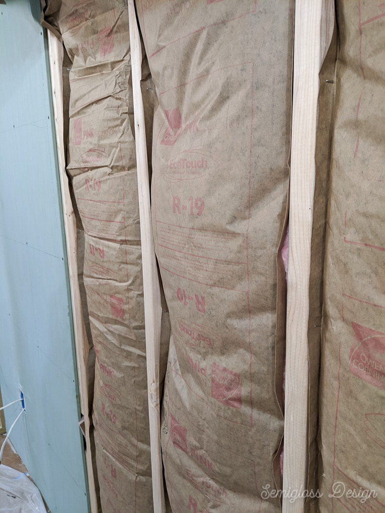 stapled sides of insulation to studs