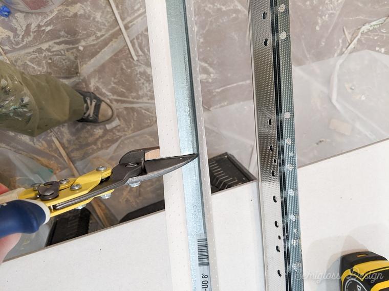 cutting drywall corners with tin snips
