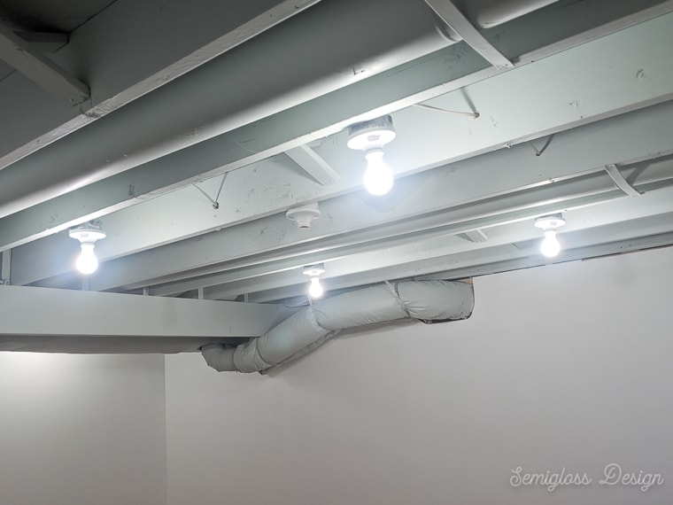 light fixtures in exposed basement ceiling