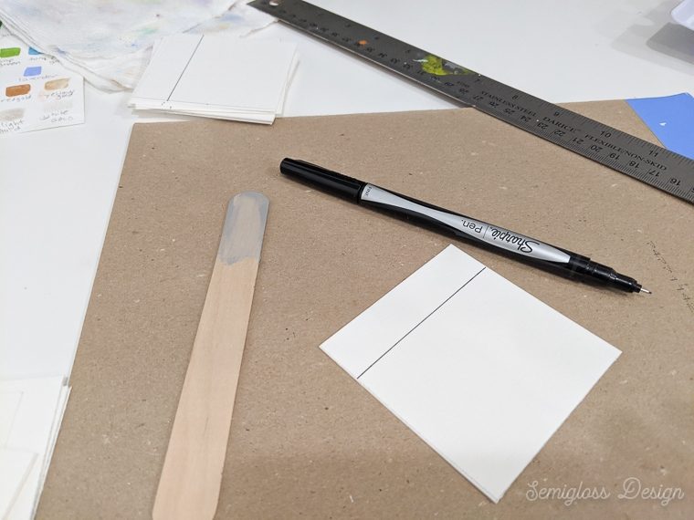 use waterproof pen to draw lines on watercolor paper for swatches