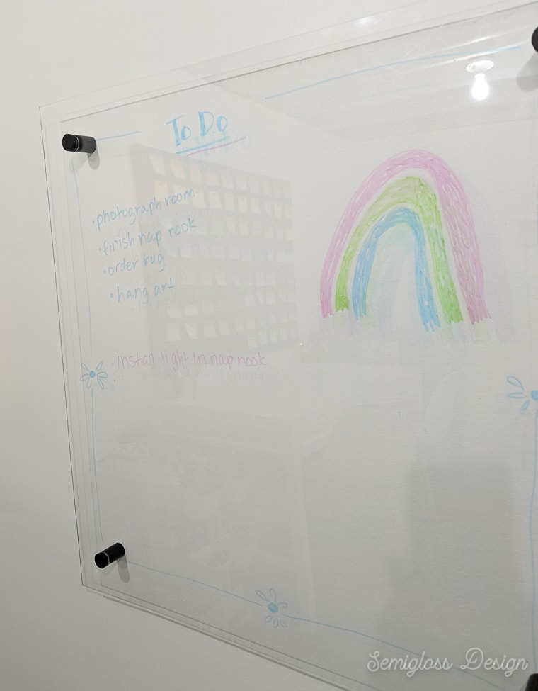 clear dry erase board on white wall