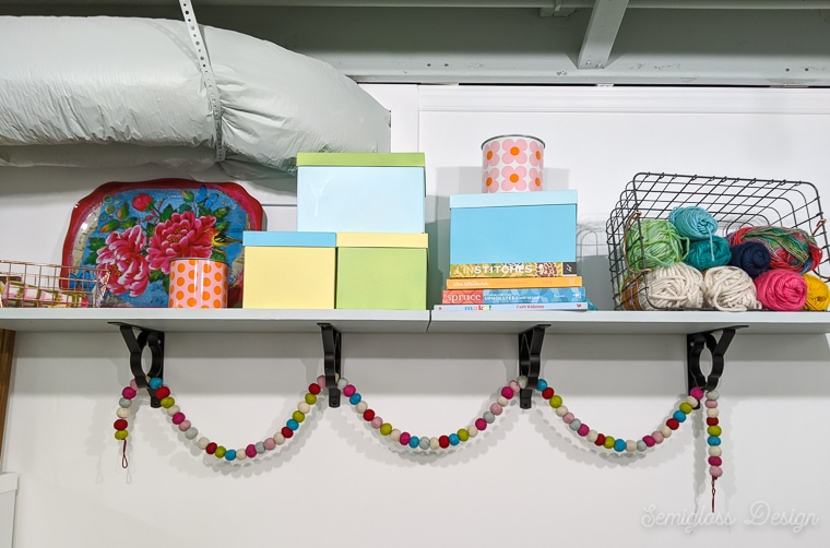 wall shelf with colorful boxes and books