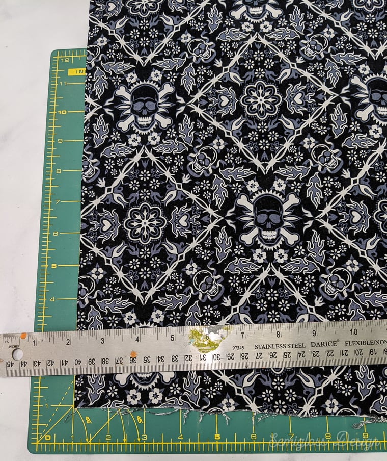 skull fabric on cutting mat with ruler