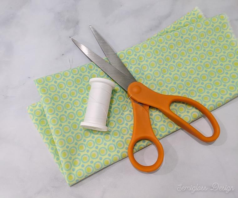 fabric, thread and scissors