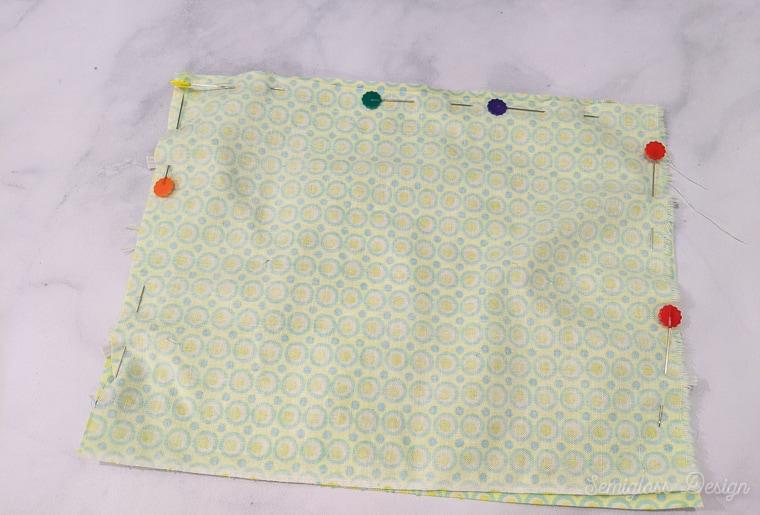 fabric pinned around edges