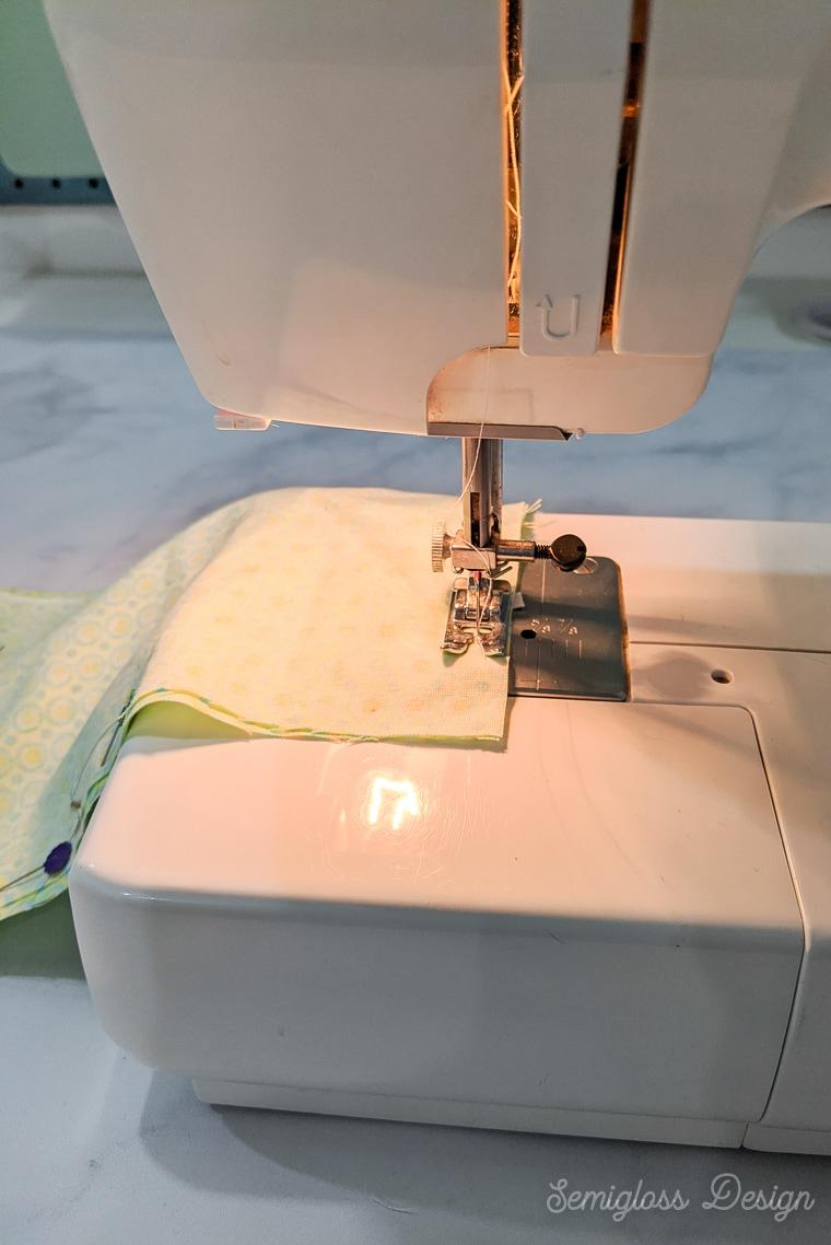 using sewing machine to sew fabric masks