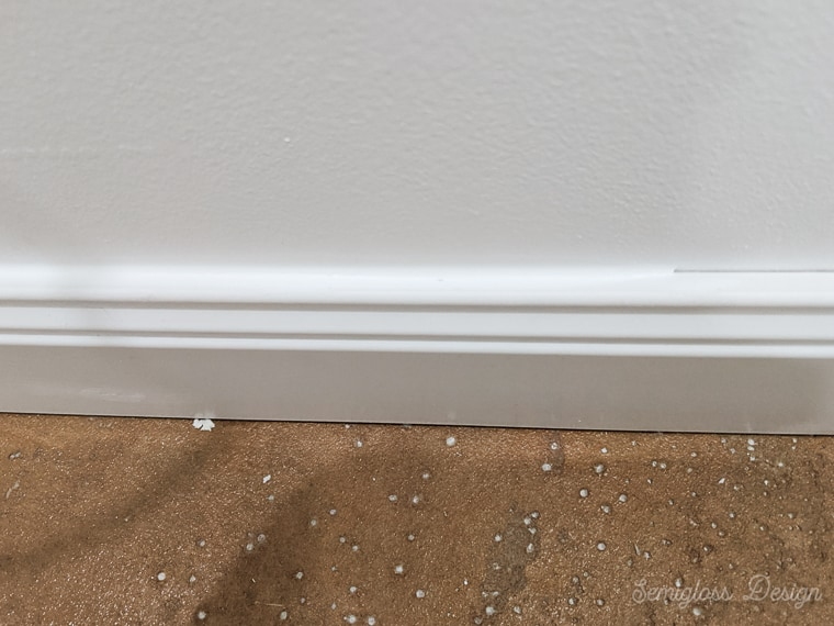 caulking edge of baseboard