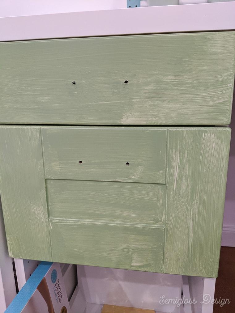 1st coat of paint on ikea sektion cabinets