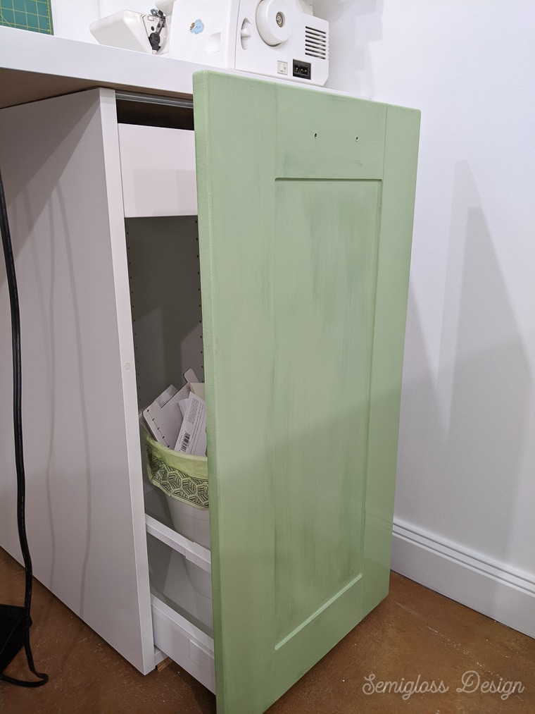 cabinet being painted green