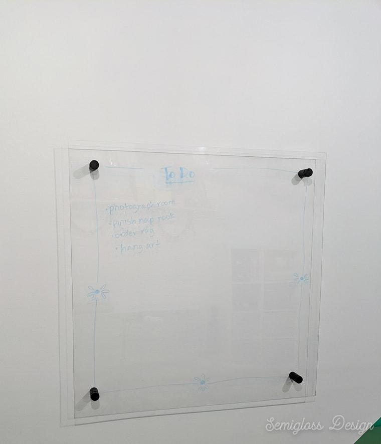 plexiglass dry erase board installed on wall