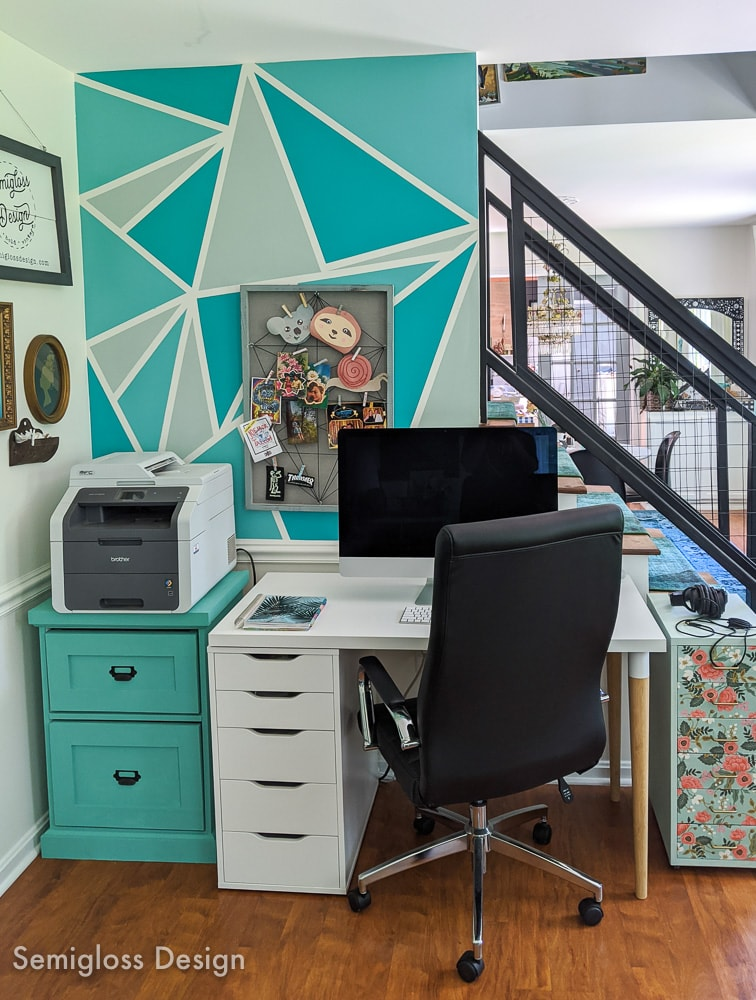 home office nook by staircase with teal triangle wall mural