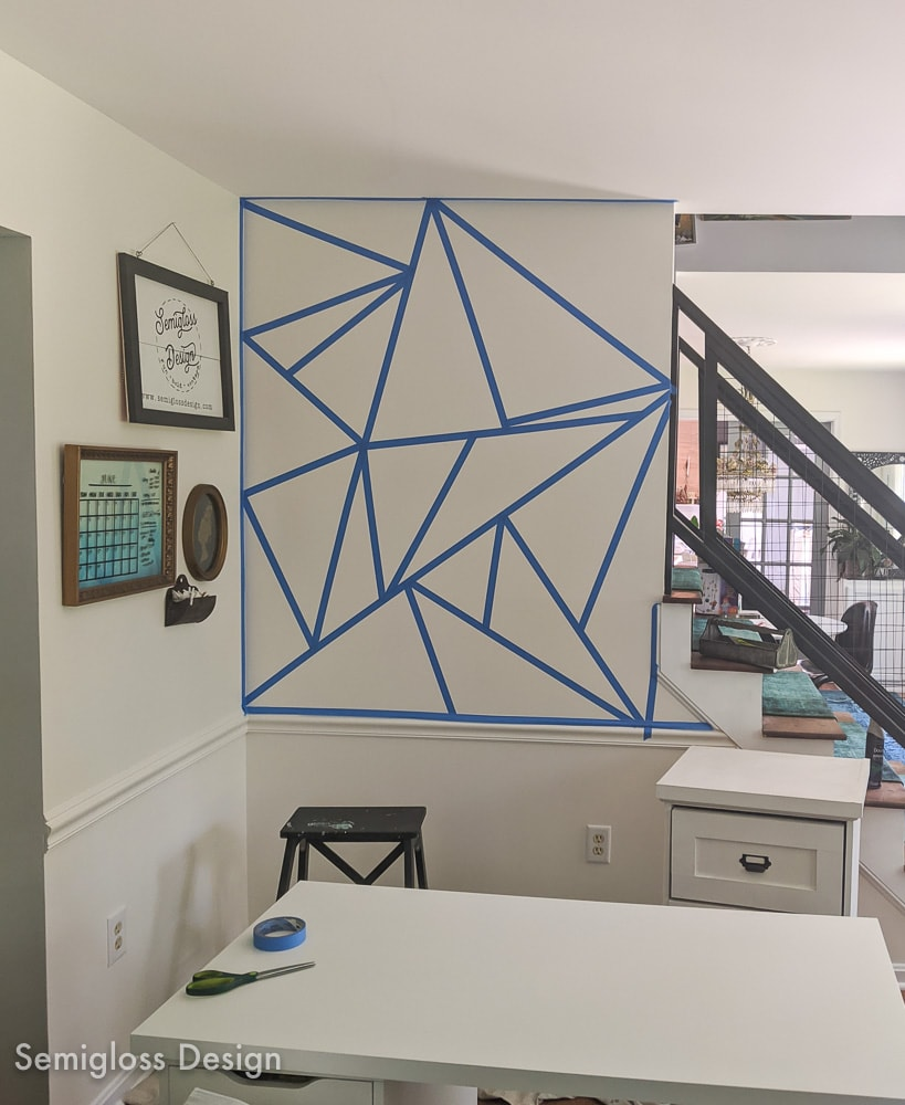 wall taped into geometric pattern