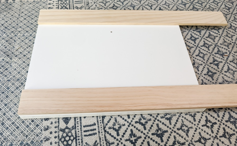 measuring wood against drawer panels