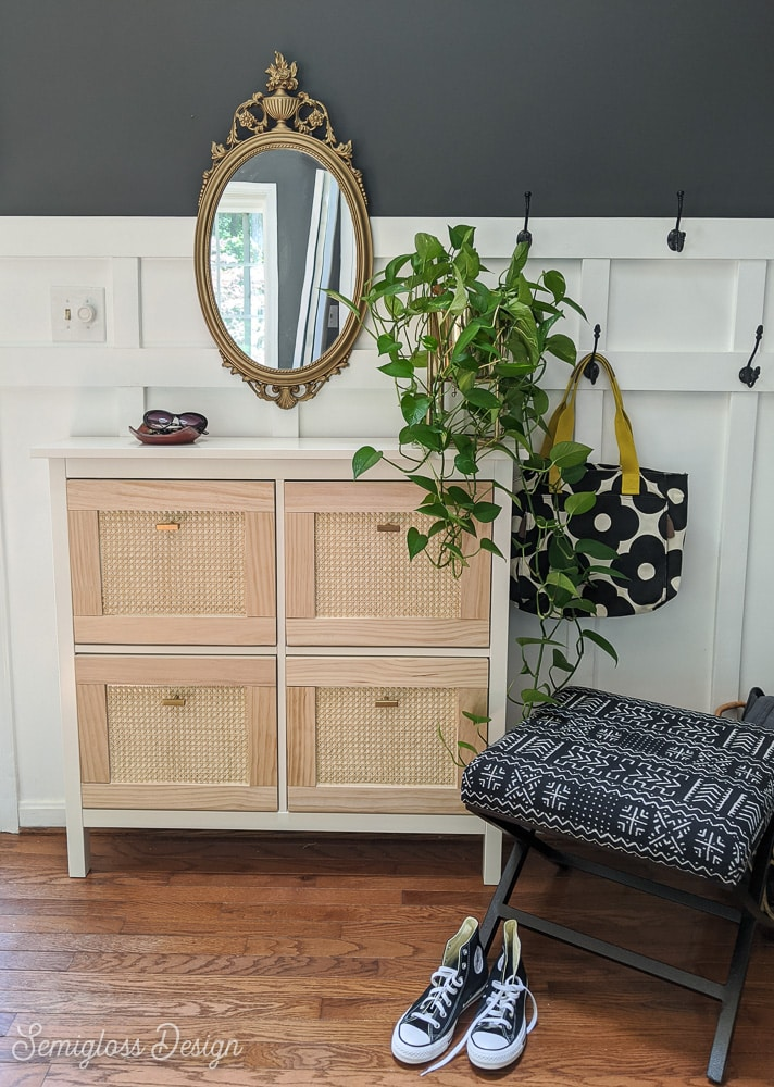 entry with IKEA shoe cabinet and ottoman