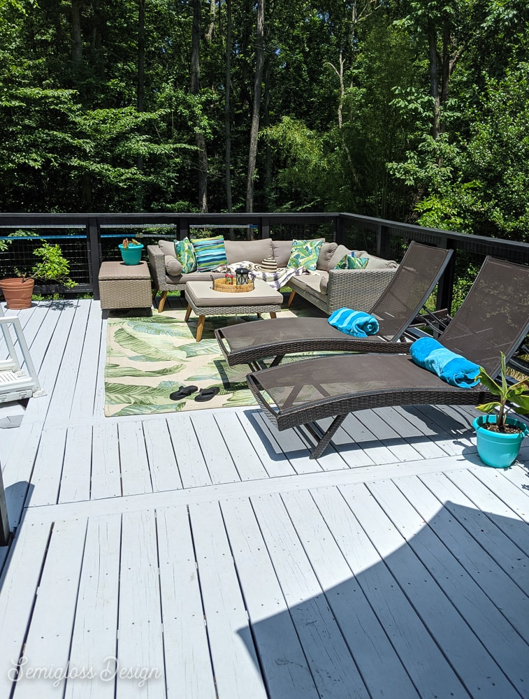 painted gray deck with patio furniture