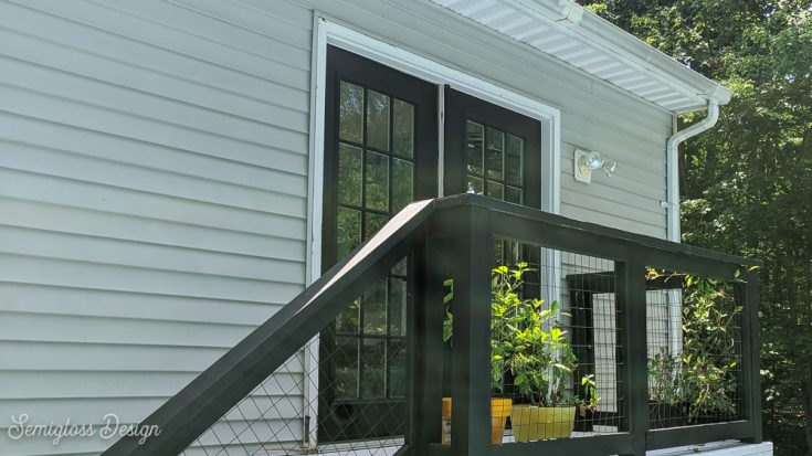 black French doors with small deck