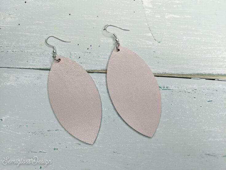 rose gold leather earrings DIY on aqua wood background