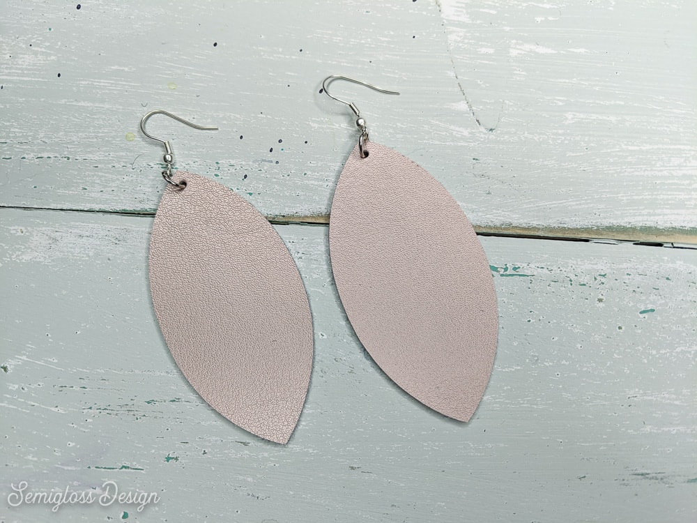 rose gold leather earrings DIY on aqua wood background
