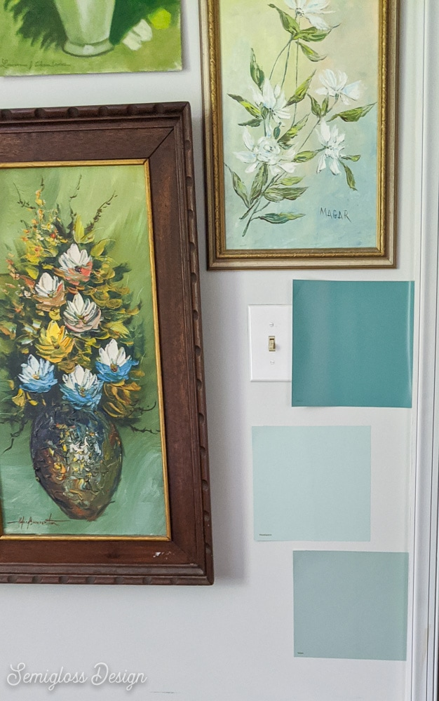 teal paint swatches on wall