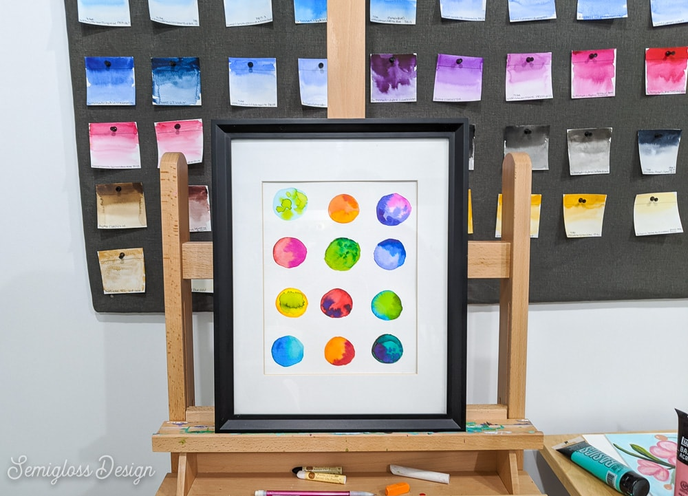 watercolor dot art on easel