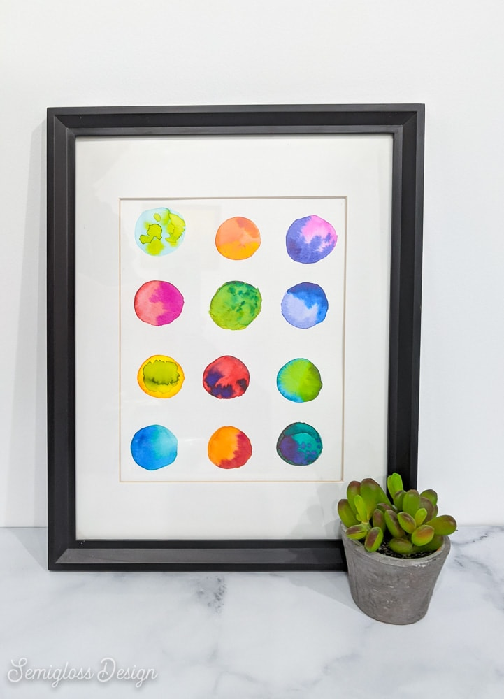 abstract watercolor art in frame with plant
