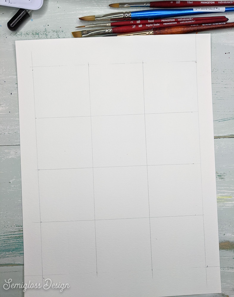 using a pencil to draw a grid on paper