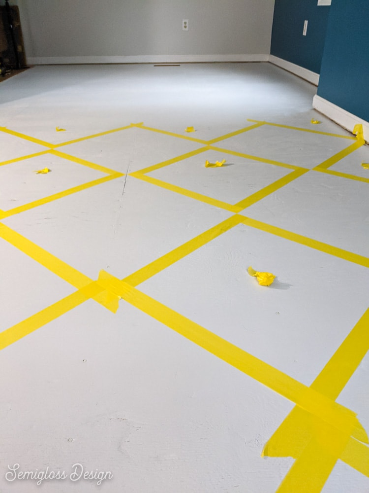taping a pattern on the floor