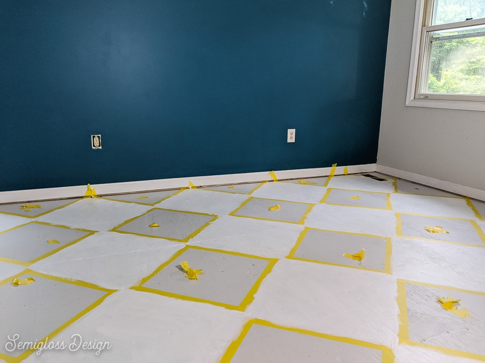 painting a floor with a checkerboard pattern