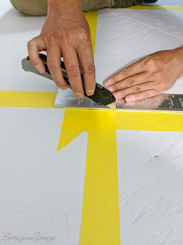 cutting corners of tape with utility knife