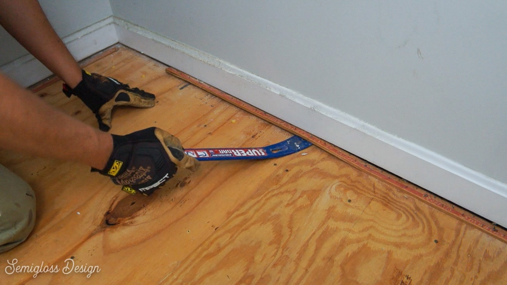 using pry bar to remove carpet tack strips