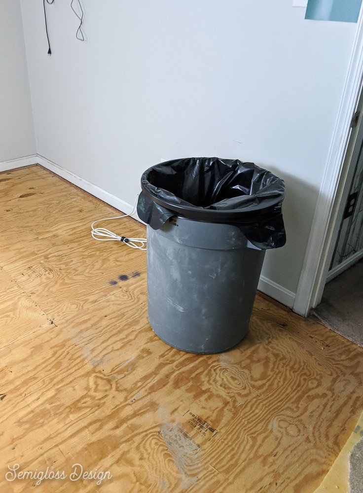 trash can for demo debris when removing carpet from room
