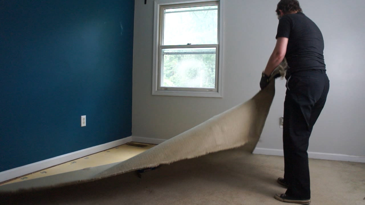 lady removing carpet